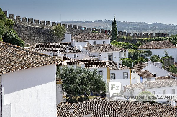 Top view of the ancient fortified village of Obidos and typical terracotta roofs Oeste Leiria District Portugal Europe.