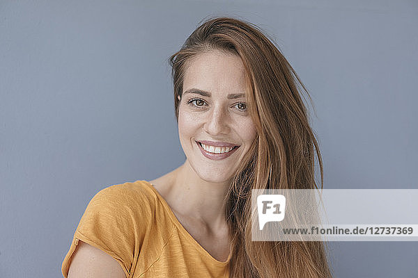 Portrait of a pretty woman  smiling  looking at camera