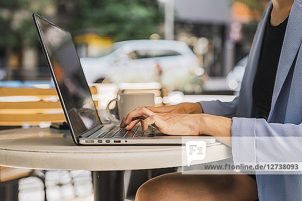 Young businesswoman sitting in coffee shop  using laptop