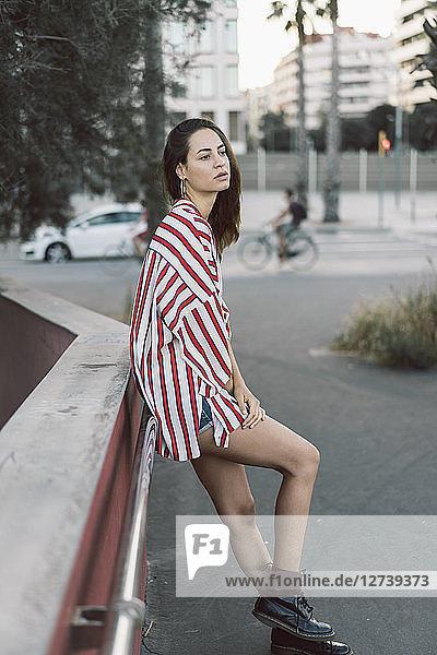 Portrait of woman wearing striped shirt