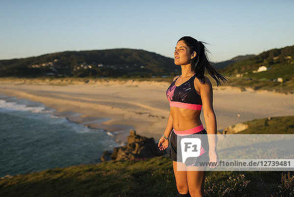 Sportive woman enjoying sunset light