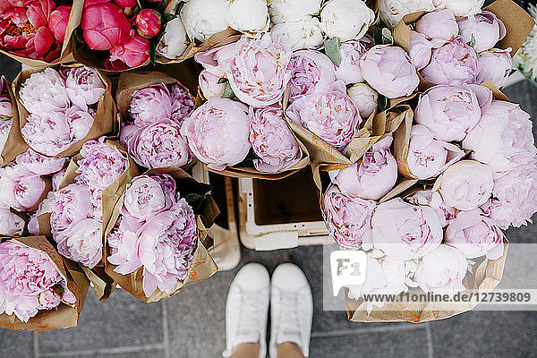Bunches of peonies at flower market