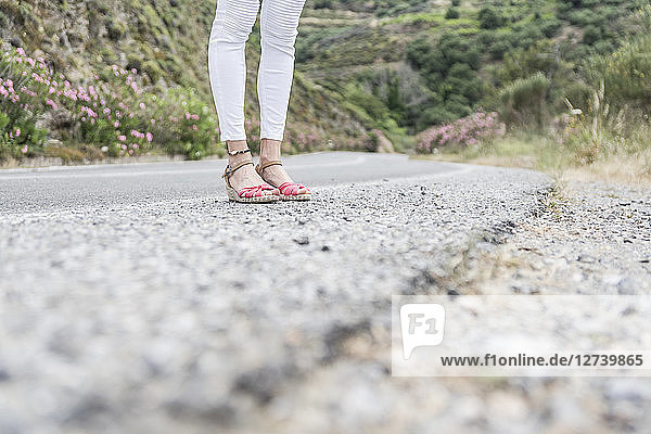 Greece  Crete  legs of woman standing at the roadside