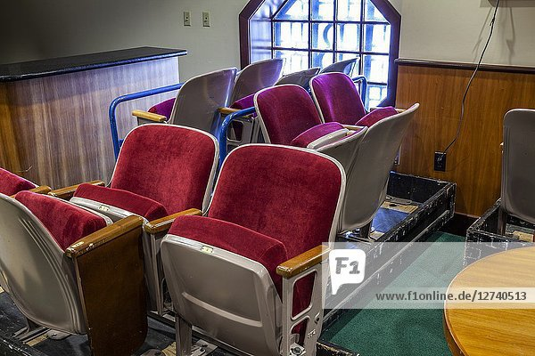 Folding chairs from a theater in storage.