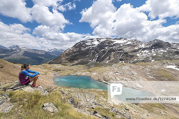 The hiker admiring the view of Bei Laghetti in Sobretta Valley  Santa Caterina Valfurva  Province of Sondrio  Valtellina  Lombardy  Italy  Europe.