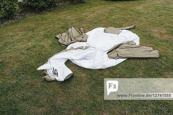 Empty inflatable pool toy on lawn