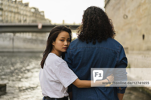 France  Paris  young couple in love at river Seine