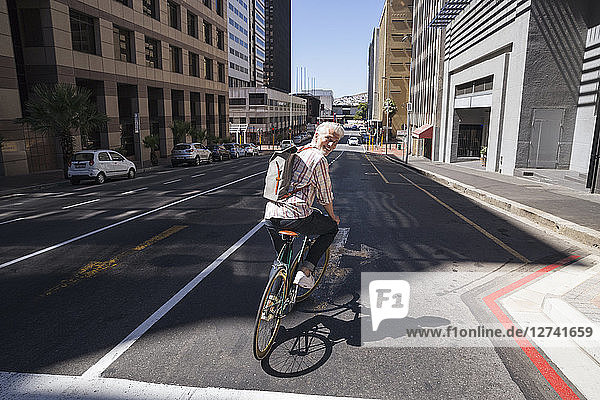 Mature man riding bicycle in the city