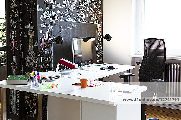 Empty desk in creative office