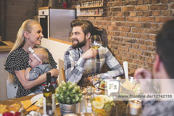 Family and friends enjoying dinner  eating  drinking  having fun