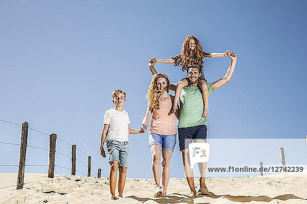 Netherlands  Zandvoort  happy family walking on the beach