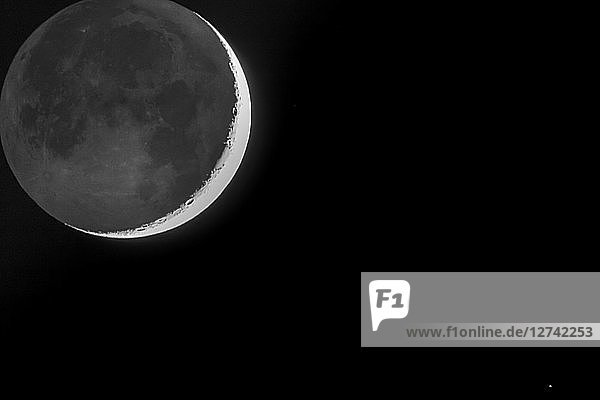 Germany  Hesse  Hochtaunuskreis  grey light and crescent of the moon with star Antares