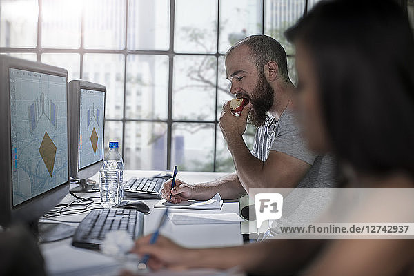 Adult Education  student eating an apple at computer training centre