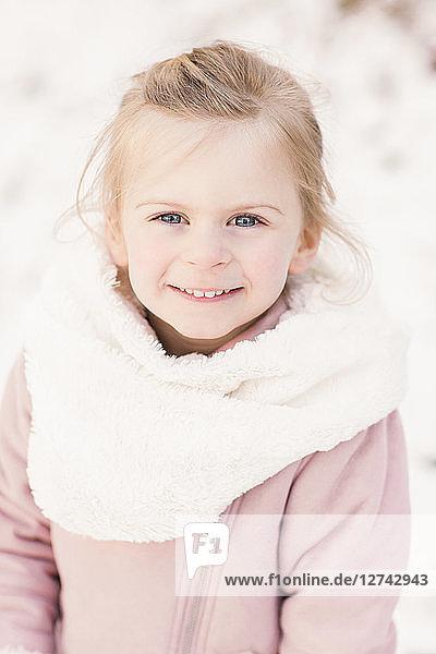 Portrait of happy little girl in winter