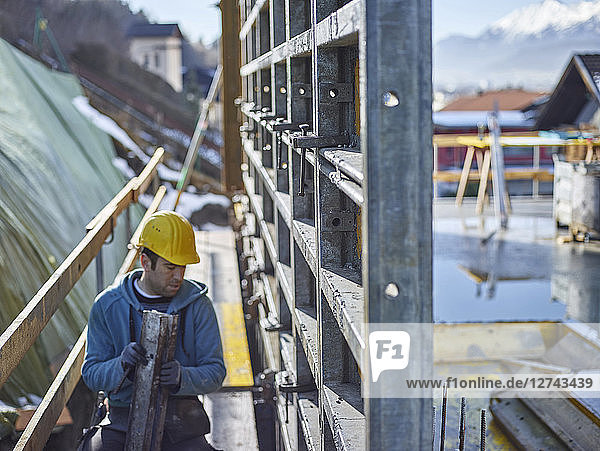 Construction worker working on plywood