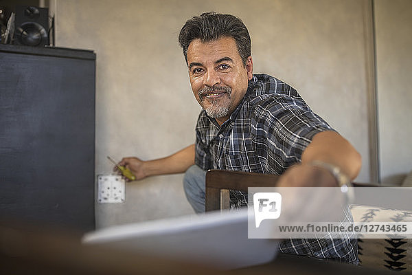 Portrait of content handyman with tablet