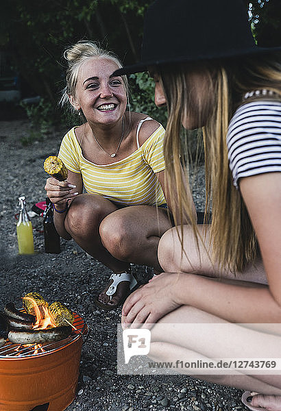 Two happy young women having a barbecue