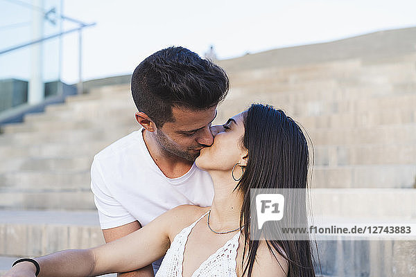 Young urban couple falling in love  kissing