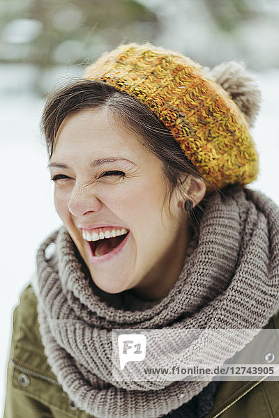 Portrait of laughing woman in the snow