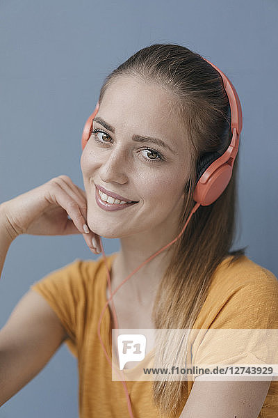Portrait of a pretty woman  using headphones