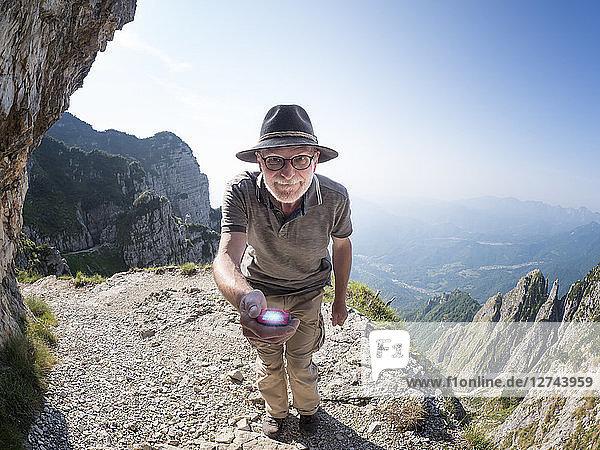 Italy  Veneto  Strada delle 52 Gallerie  hiker holding torch