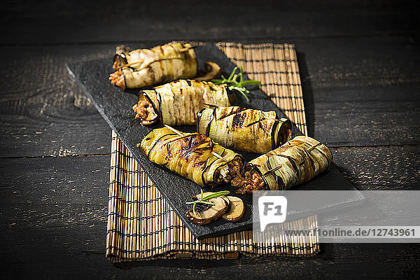 Grilled aubergine slices stuffed with mince meat  champignons and goat cheese