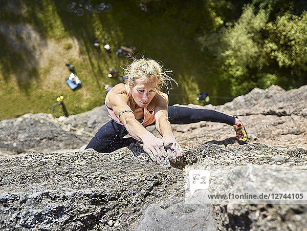 Austria  Innsbruck  Hoettingen quarry  woman climbing in rock wall