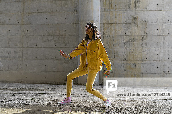 Woman wearing yellow jeans clothes  dancing