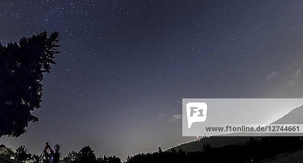 Germany  Hesse  Hochtaunuskreis  Bright Perseid Meteor burning out over Taunus Ranges
