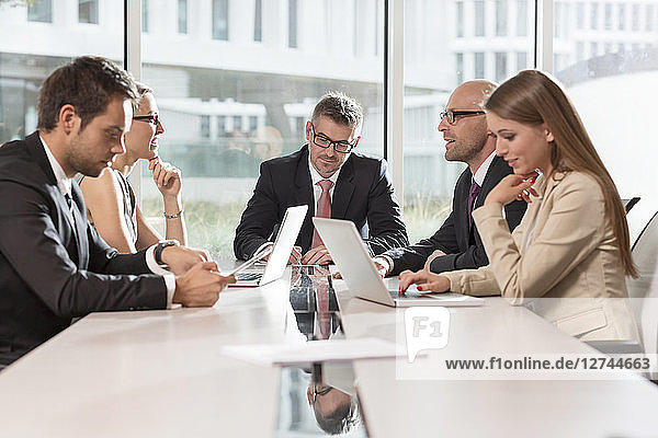 Poland  Warzawa  group of five businessmen having meeting at conference room in hotel
