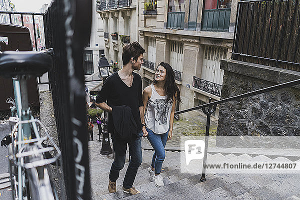 France  Paris  young couple walking in the district Montmartre