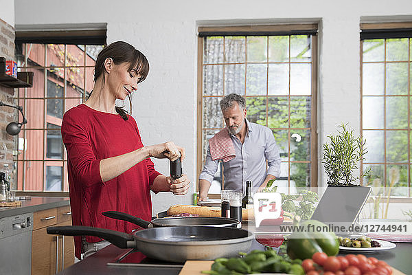 Couple in kitchen  preparing food toghether