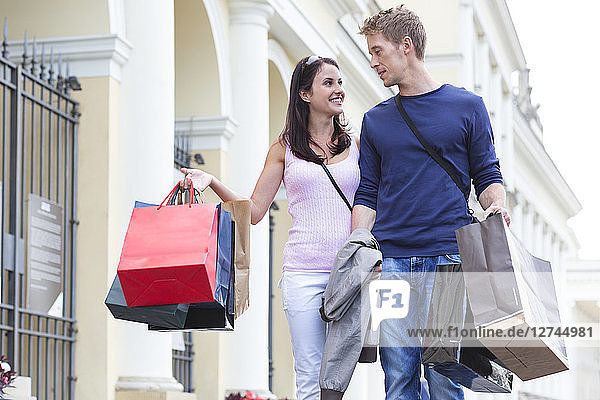 Poland,  Warsaw,  Young couple on a shopping spree