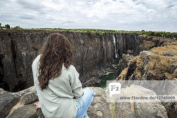 Zimbabwe  woman watching Victoria Falls