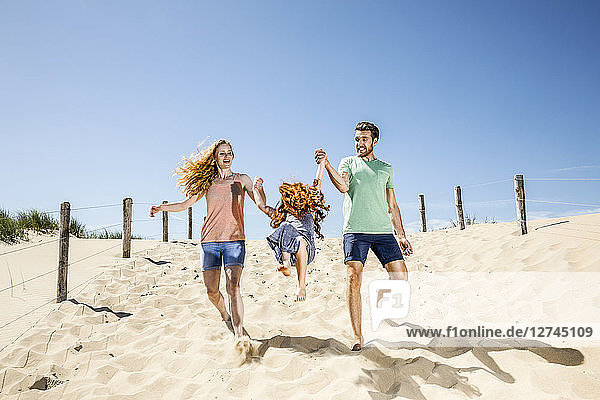 Netherlands  Zandvoort  happy family with daughter on the beach