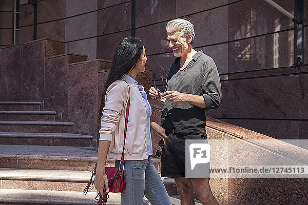 Mature couple meeting in the city