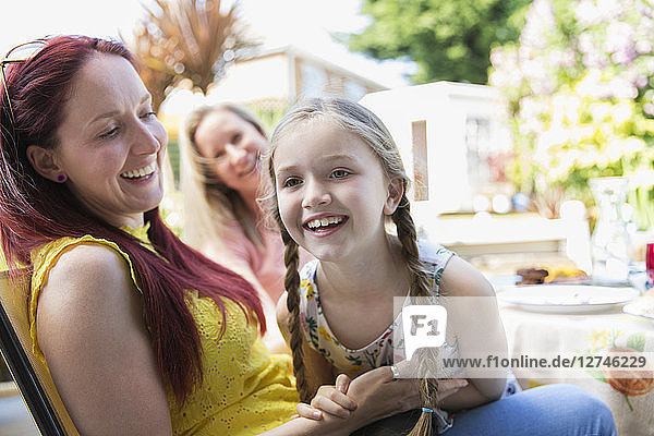 Affectionate mother and daughter on patio