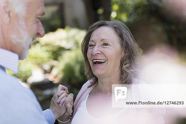 Happy  affectionate senior couple in garden