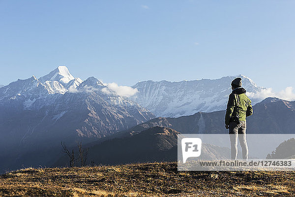 Solo female traveler looking at majestic mountain view  Jaikuni  Indian Himalayan Foothills
