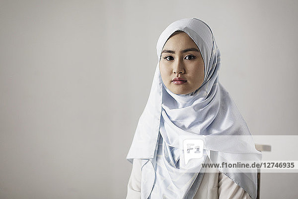 Portrait confident  serious young woman wearing hijab