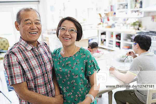 Portrait happy senior father and daughter in kitchen