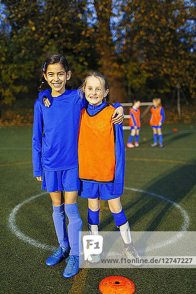 Portrait smiling  confident girl soccer players