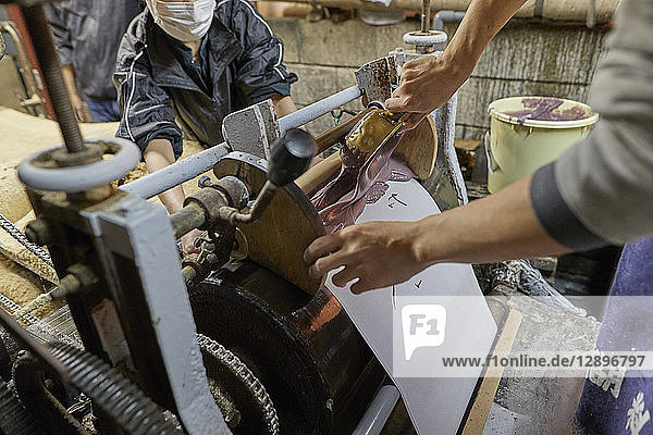 Japanese artisans working in the studio