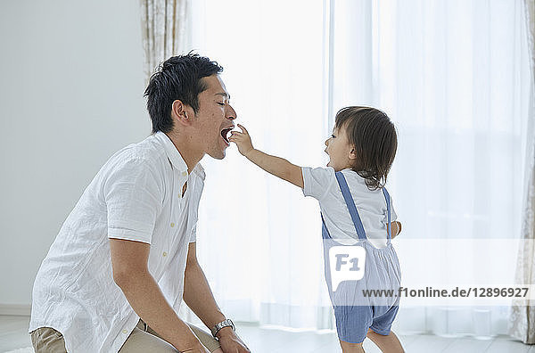 Japanese father and son at home