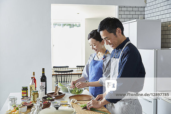 Japanese mature couple in the kitchen