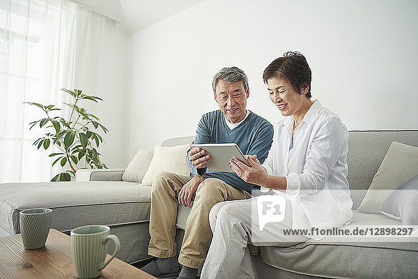 Japanese senior couple on the sofa