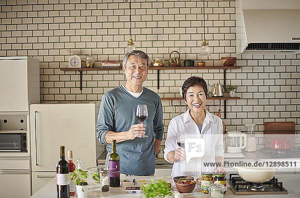 Japanese senior couple in the kitchen