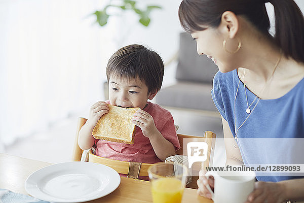 Japanese mother and kid having breakfast