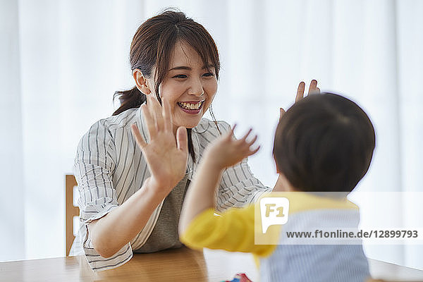 Japanese mother and kid playing