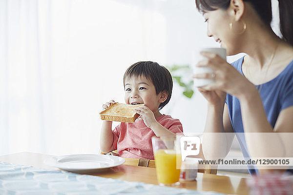 Japanese mother and kid having breakfast